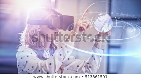 Composite image of woman using a virtual reality device Stock photo © wavebreak_media