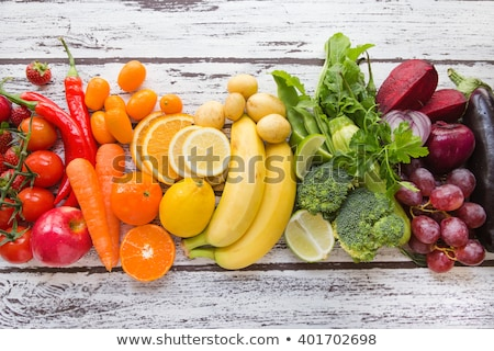 Wooden box with multicolored baby potatoes Stock photo © ozgur