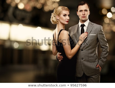 retro rich woman in black dress Stock photo © ssuaphoto