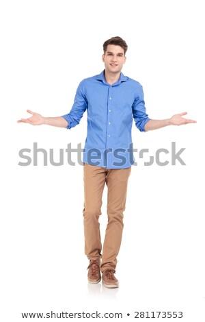 smiling casual man welcoming you and walking forward  Stock photo © feedough