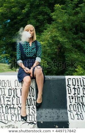 Lány elektronikus cigaretta titokzatos fiatal lány szemek Stock fotó © tekso