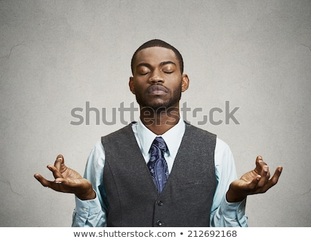 Stock photo: Young black man meditating with closed eyes in lotus pose. Yoga