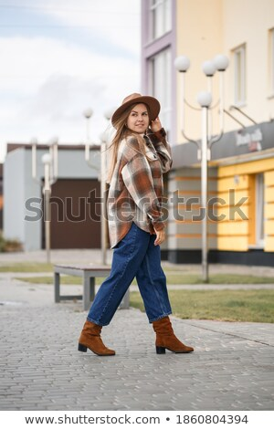 Young pretty girl with long brown hair, in checkered shirt posin Stock photo © deandrobot