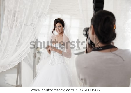 Stock photo: Young pretty bride with photo camera