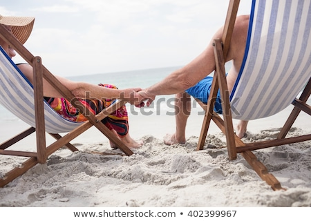 Couple homme amusement Romance séance loisirs Photo stock © IS2