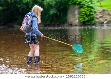 young girl fishing with net stock photo © is2