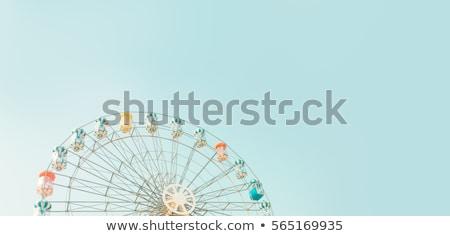 ferris wheel and sky stock photo © givaga