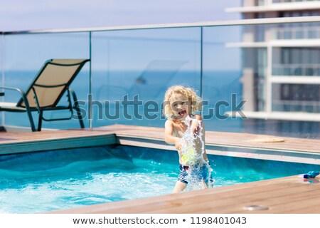 Fiatal srác ugrik végtelen medence gyermek jókedv Stock fotó © IS2