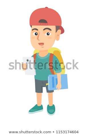 Kaukasisch schooljongen mobieltje leerboek glimlachend Stockfoto © RAStudio