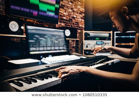hands playing piano at sound recording studio Stock photo © dolgachov