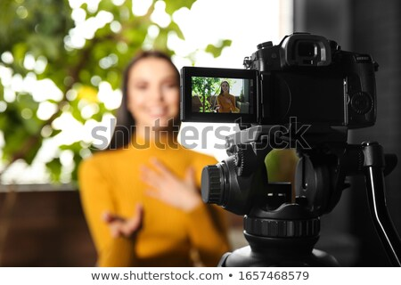 female bloggers with camera recording home video Stock photo © dolgachov