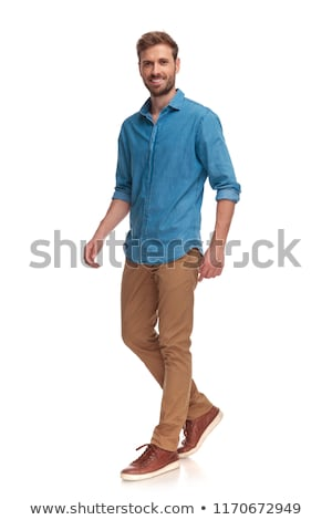 side view of young blond man stepping to side stock photo © feedough