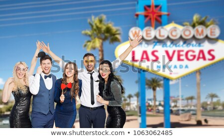 happy friends with party props in las vegas Stock photo © dolgachov