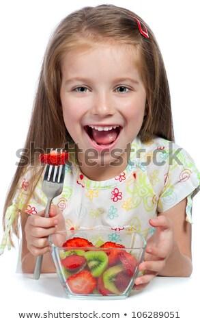 Portrait peu cute fille manger fruits frais Photo stock © dashapetrenko