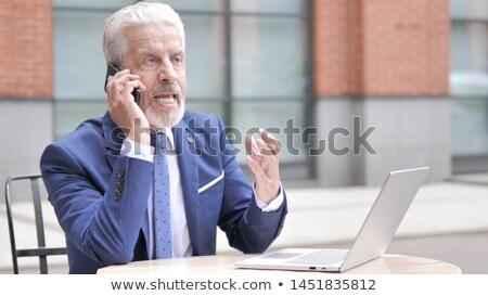 altos · hombre · enojado · oficina · de · trabajo · portátil - foto stock © minervastock