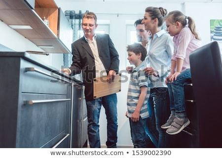 Eladó mutat család tulajdonságok új konyha Stock fotó © Kzenon