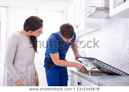 Repairman Installing Induction Stove Stock photo © AndreyPopov