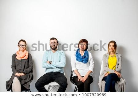 jonge · vrouw · vergadering · stoel · wachten · sollicitatiegesprek · muur - stockfoto © feedough