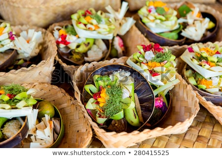 Traditional balinese offerings to gods in Bali with flowers and aromatic sticks Stock photo © galitskaya
