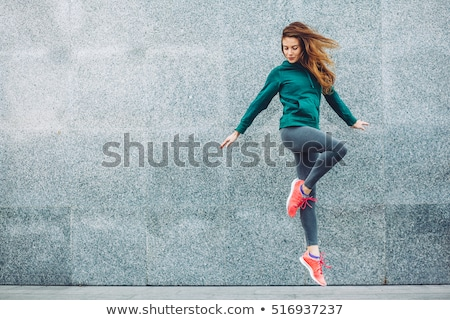 A sport girl in fashion sportswear doing fitness exercise in the street, outdoor sports, urban style stock photo © ElenaBatkova