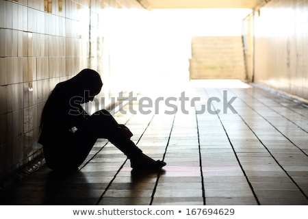 teenager depressed inside a dirty tunnel Stock photo © Lopolo