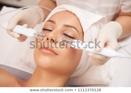 woman having hydradermie facial treatment in spa stock photo © dolgachov