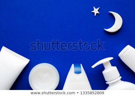 Face cream moisturizer jar on blue background, moisturizing skin Stock photo © Anneleven