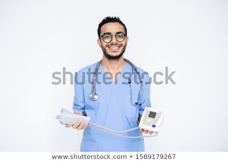 Happy young successful male clinician with toothy smile holding tonometer Stock photo © pressmaster