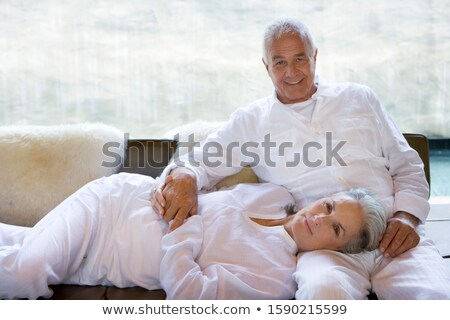 Side view of senior Caucasian couple sitting and posing on sofa at retirement home  Stock photo © wavebreak_media