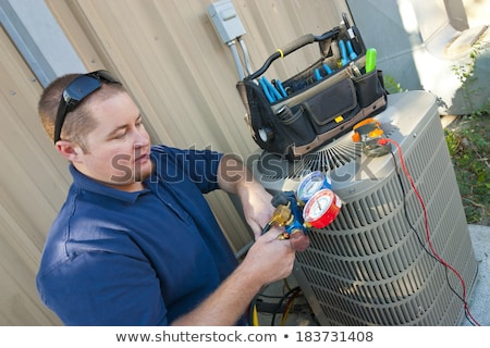Technician Testing Air Conditioner Stock photo © AndreyPopov