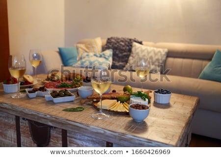 Vacsora harapnivalók borospoharak asztal nappali fa asztal Stock fotó © dashapetrenko