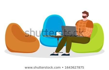 Man zitten werk laptop gezellig werkplek Stockfoto © robuart
