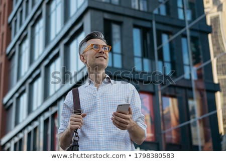 изображение красивый бизнесмен очки глядя Сток-фото © deandrobot