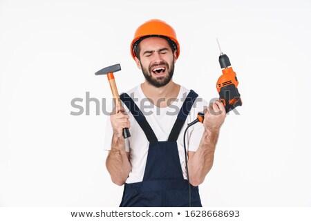 Szomorú fiatalember tart fúró kalapács kép Stock fotó © deandrobot