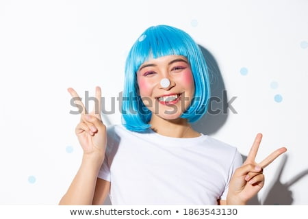 Image of asian girl wearing white wig smiling and gesturing peac Stock photo © deandrobot