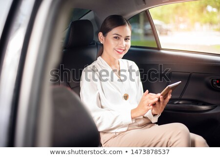 Businesswoman Talking On Mobile Phone Travelling In Limousine Stock photo © diego_cervo