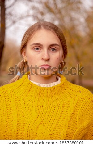 Beautiful girl with pigtail and in sweater with pattern Stock photo © RuslanOmega