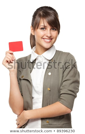 closeup portrait of young pretty woman holding business card stock photo © hasloo