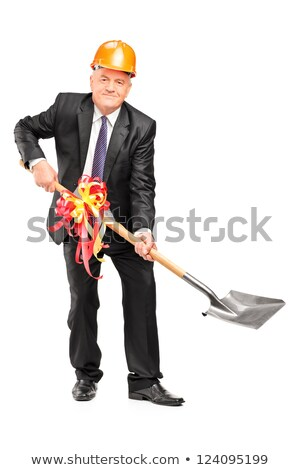 businessman wearing helmet and holding a shovel Stock photo © photography33