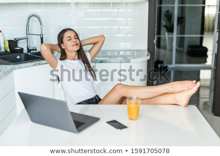 Woman with her hands behind her neck stock photo © photography33