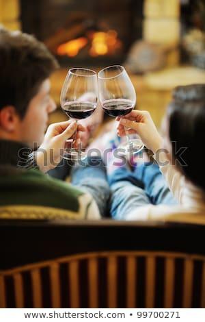 jonge · romantische · paar · vergadering · sofa · haard - stockfoto © dotshock