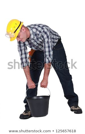 Builder struggling to carry equipment Stock photo © photography33