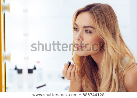 Adding Touches To Her Make Up And Applying Lipstick Stock photo © stuartmiles