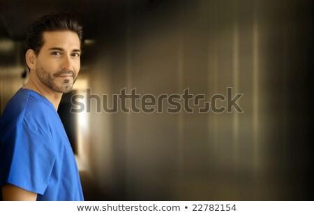 Smiling male nurse alone in a corridor stock photo © photography33