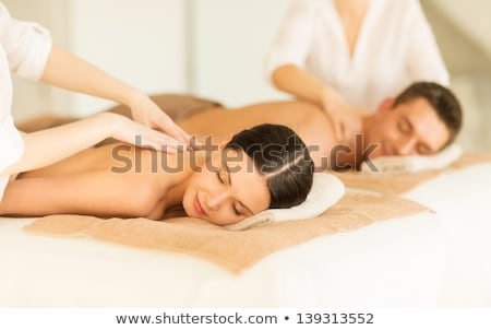 Attractive young man getting spa massage stock photo © stockyimages