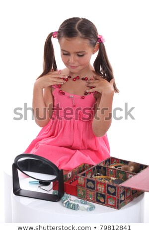 Girl playing with her mother's jewellery Stock photo © photography33