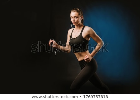 sporty woman on black background stock photo © nobilior