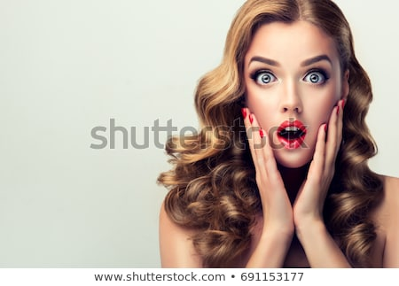 shocked woman Stock photo © dolgachov