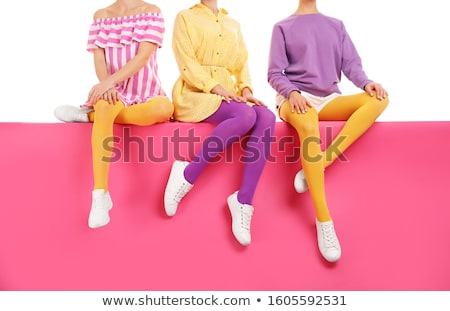 Girl in different colored tights Stock photo © kalozzolak