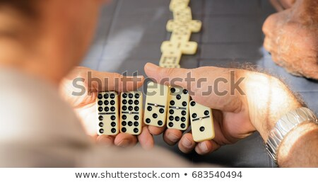 Hand of a man playing with dominoes Stock photo © photography33